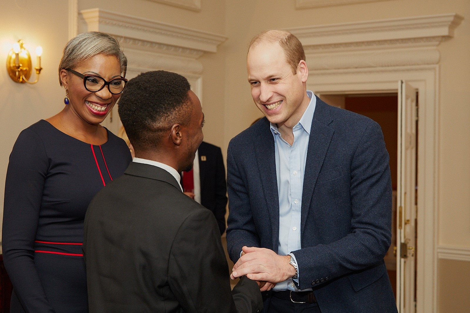 Erick gets congratulated by Prince William
